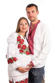 Young couple in Ukrainian style clothing on white — Stock Photo