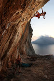 Rock climber at sunset. Kalymnos Island, Greece. — Stock fotografie