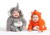 Two baby boys dressed in animal costumes on white — Stock Photo