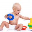Cute little boy playing with pyramid toy on white — Stock Photo #40187799