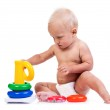 Cute little boy playing with pyramid toy on white — Stock Photo #40187893
