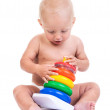 Cute little boy playing with pyramid toy on white — Stock Photo #40187969