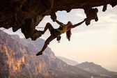 Rock climber at sunset — Stock Photo