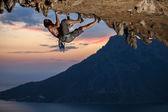 Rock climber at sunset — Stock Photo