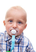 Cute blonde blue-eyed little boy with a pacifier — Stock Photo