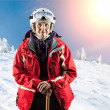 Old woman standing on snow holiday in mountains — Stock Photo