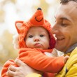 Young man and his little son in fox costume — Stock Photo