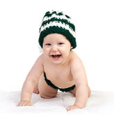 Happy baby boy in knitted hat crawling over white — Stock Photo