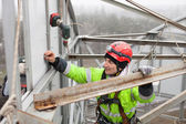 Industrial climber on a metal construction — Stock Photo
