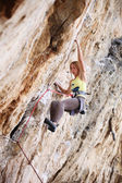 Young female rock climber on a cliff — Stock Photo