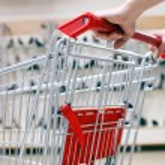Woman pushing shopping cart in shoe store, close-up — Stock Photo #4294248