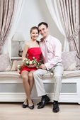 Happy young couple in luxury interior — Stock Photo