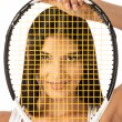 Female looking through strings of tennis racket — Stock Photo #47580191