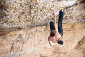 Rock climber a face of a cliff — Stock Photo