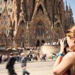 Young woman taking picture of Sagrada Familia, Barcelona, Spain — Stock Photo #50171433
