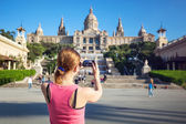 Young woman taking picture of Catalan Art Museum (MNAC) — Stock Photo