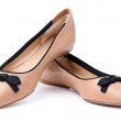 Pair of beige female shoes over white — Stock Photo #9654104