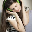 Woman listening to music — Stock Photo #12762248