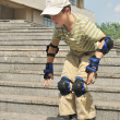 The boy practices to skate at the roller blades — Stock Photo