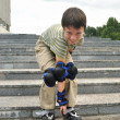 The boy with roller blades looks into the objective of camera — Foto Stock