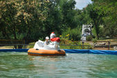 The school boy boats in the park amusement — Stock Photo