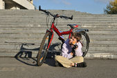 The boy and red bicycle — Stock Photo