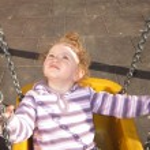 Portrait of girl swinging on swing. — Stock Photo #34735385