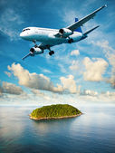 Jet is maneuvering over the tropical island — Stock Photo