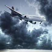 Jet is maneuvering in a dark stormy sky — Stock Photo