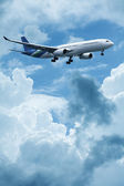 Jet plane above the clouds — Stock Photo