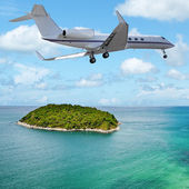 Private jet over the tropical island. Square composition. — Stock Photo
