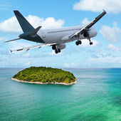 Jet maneuvering over the tropical island. Square composition. — Stock Photo