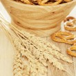 Pretzels and wheat. Vertical shot, shallow depth of field. — Stock Photo