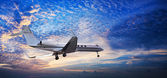 Panoramic composition of small private jet in a sunset sky — Stock Photo