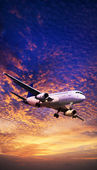 Jet aircraft maneuvering in a sunset sky. Vertical panoramic com — Stock Photo