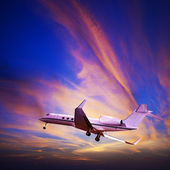 Private jet maneuvering in a spectacular sunset sky. Square comp — Stock Photo