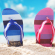 Flip-flops on the beach. Panoramic composition. — Stock Photo