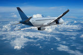 Jet cruising above the clouds — Stock Photo