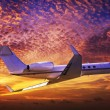 Private jet cruising in a sunset sky — Stock Photo