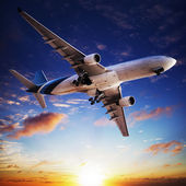 Jet cruising at sunset — Stock Photo