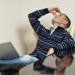 Yang man getting tired during computer work. — Stock Photo