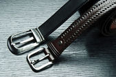 Two men's belts on grey background — Stock Photo