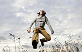 Yang man dressed casual way is running outside — Stock Photo