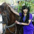 Stock Photo: Gipsy girl with horse.