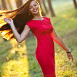 Portrait of yang sexy woman in the forest sunset background — Zdjęcie stockowe