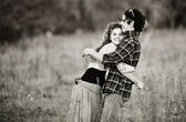Picture of vintage way dressed yang pretty couple outdoor — Stock Photo