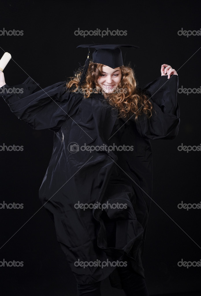 Studio portrait of beautiful curly female graduating student dressed in cup and gown — Stock Photo #18547347
