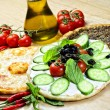 Traditional Eastern plate of manaqish,flat bread topper with cheese and different ingredients — Stock Photo