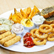 Plate with different kinds of appetizers - Stock Photo