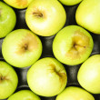 Green apples composition in the box — Stock Photo